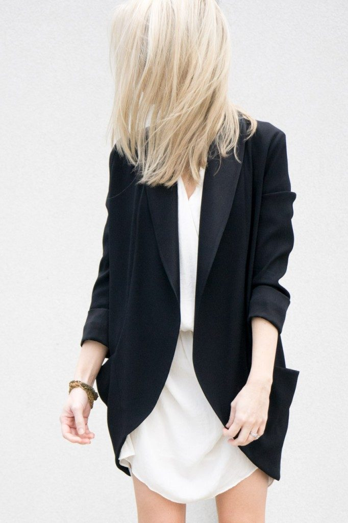 Figtny is wearing a black oversized tuxedo inspired blazer from Wilfred