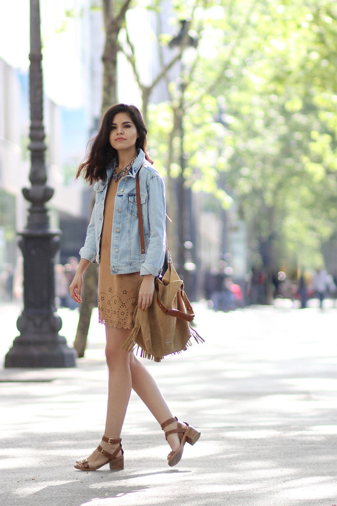 How To Wear A Suede Dress: Adriana Gastélum is wearing a camel suede dress with a fringed suede sidebag