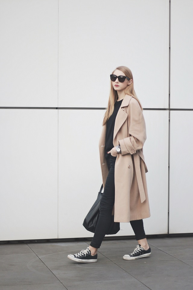 Pavlina Jagrova is wearing a second hand camel trench coat with a black Topman sweater and a pair of Topshop skinny jeans