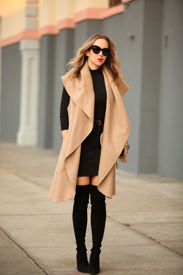 Helena Glazer is showing off the black and camel trend with a sleeveless Zara coat and mini dress from Susana Monaco