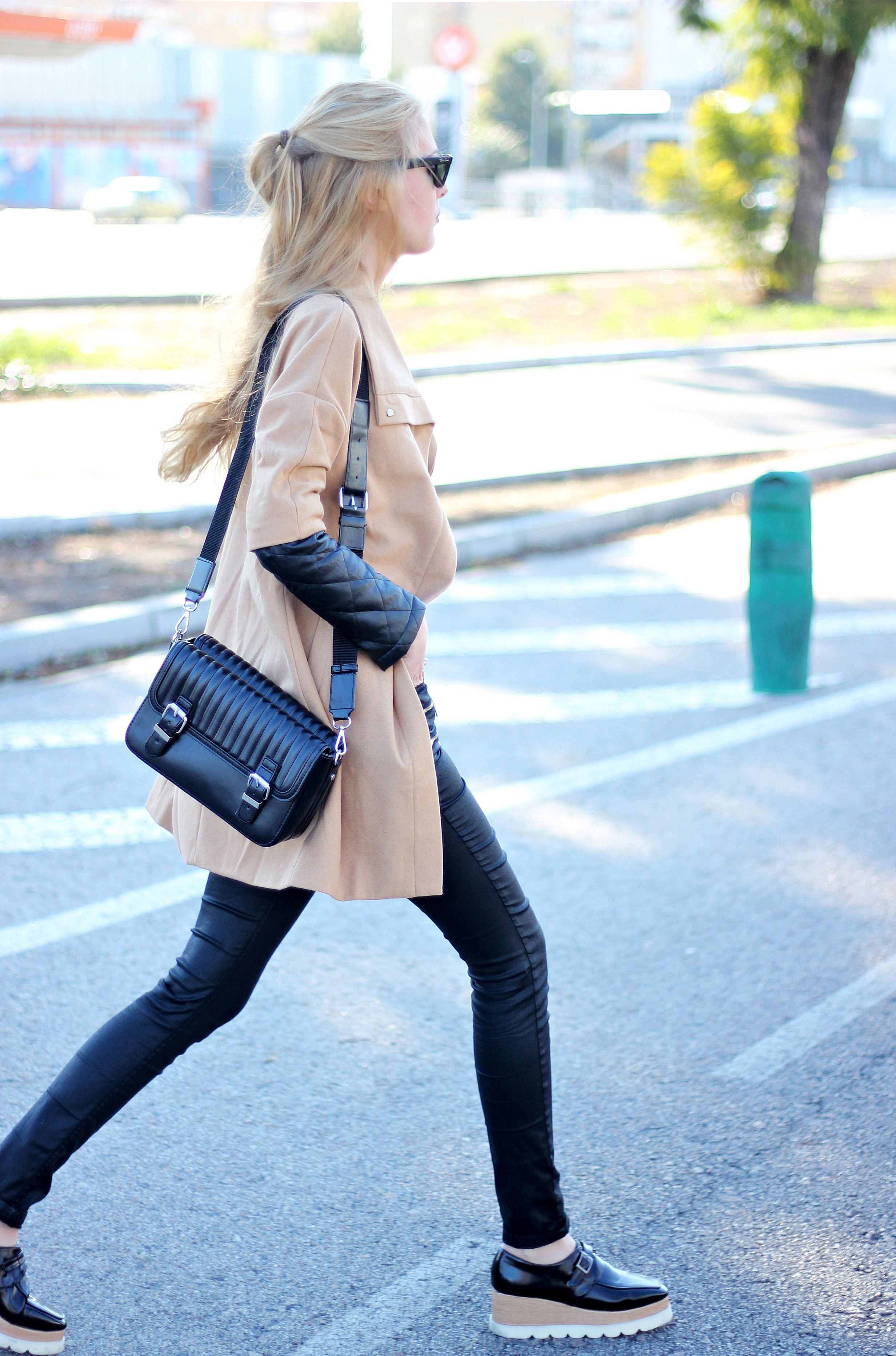Marta Martin is showing the black and camel trend with a Style moi coat and leather trousers