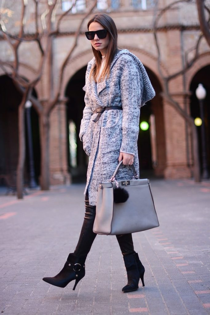 Zina Charkoplia is wearing a grey cardigan from Minusey and the belt is from Zara