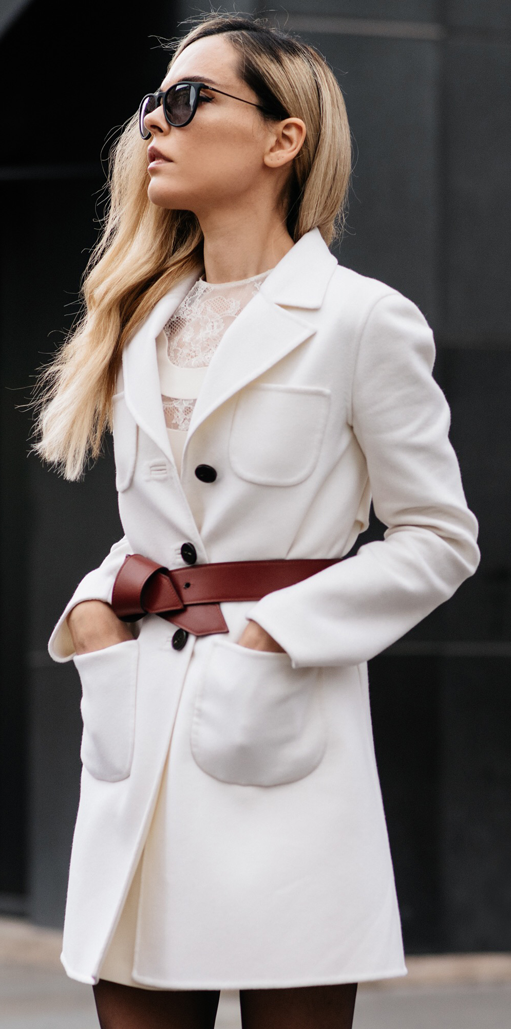 Belt Trend 2015: Evangelie Smyrniotaki is wearing a white lace dress and coat fro Valentino, and the belt is from Louis Vuitton