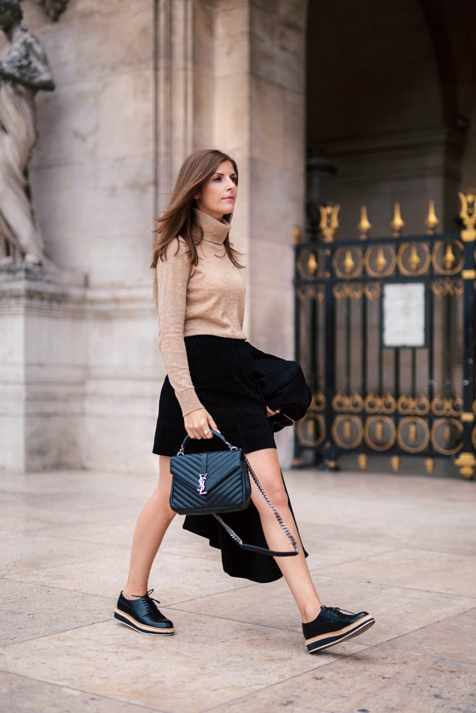 Valerie Husemann  pairs a gorgeous camel polo neck jumper with a black mini skirt and a fresh take on the brogues trend. Adapt this look for colder weather by wearing it with tights or a scarf!  Outfit: Selected Femme.