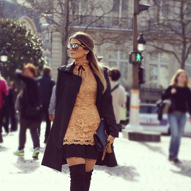 Ariane Canovas is wearing all black and camel