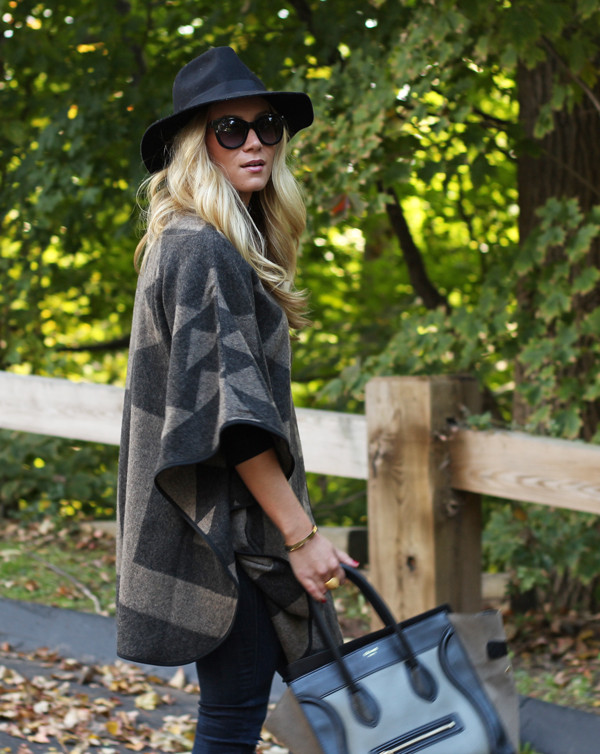 Marissa Meade wears the blanket coat trend with jeans, shades, and a wide brimmed hat. Coat: Talbots, Jeans: Nordstrom.
