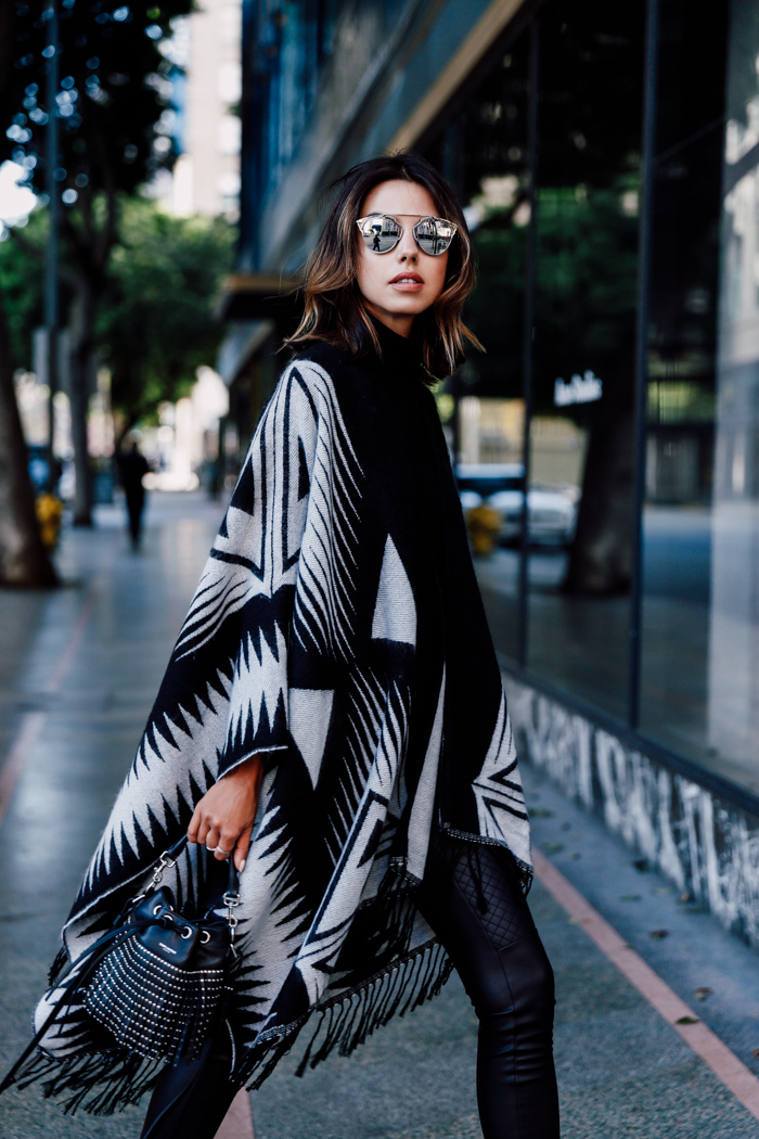 Annabelle Fleur wears an edgy aztec style blanket coat. Blanket Coat/Leggings/Sweater: Express.