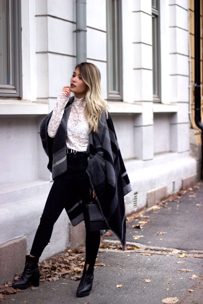 This classic greyscale blanket coat looks ultra cool worn with a sheer lace top and skinny black jeans. Via gigglesndimples.  Top: KappAhl, Poncho: Holzweiler, Shoes: Alexander Wang, Belt: The Kooples, Bag: Adax.