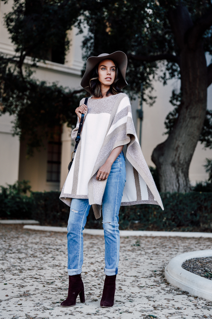 Annabelle Fleur looks ultra glamorous in this cream and beige poncho from Club Monaco. Wear a similar piece over jeans with a pair of Chelsea boots to steal Annabelle's look! Poncho: Club Monaco, Jeans: Citizens of Humanity, Boots: Chelsea Paris.