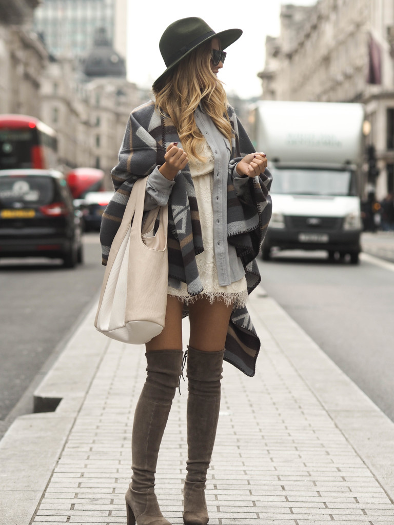 Pair a blanket coat with over the knee boots and a wide brimmed hat for casual sophistication. Via Lene Orvik. Shoes: Stuart Weitzman, Poncho & Hat: Miss Selfridge.