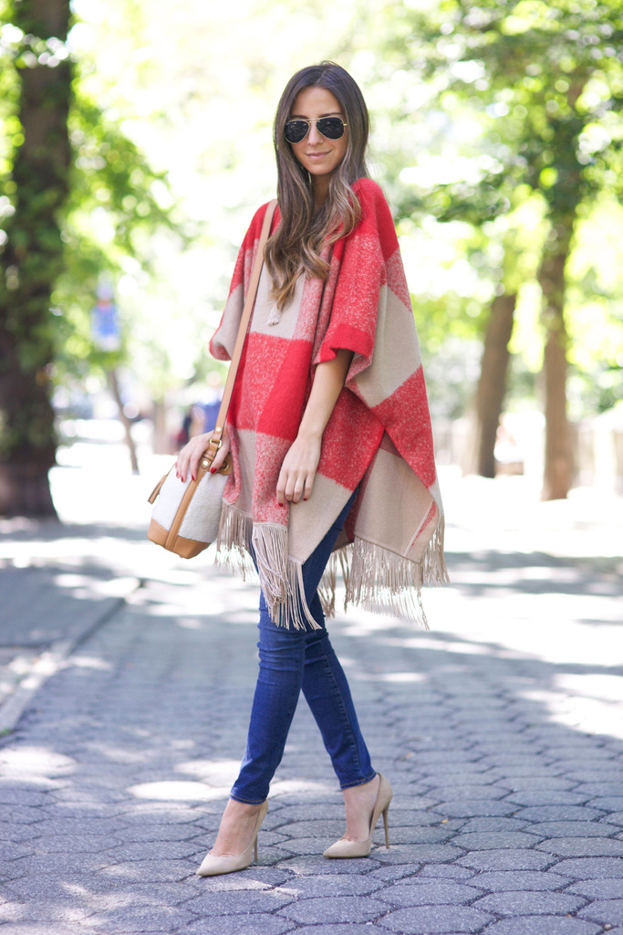 This cute red and beige gingham blanket coat goes a treat with skinny denim jeans and pale heels. Via Arielle Nachami. Poncho/Bag: Adam Lippes for Target.