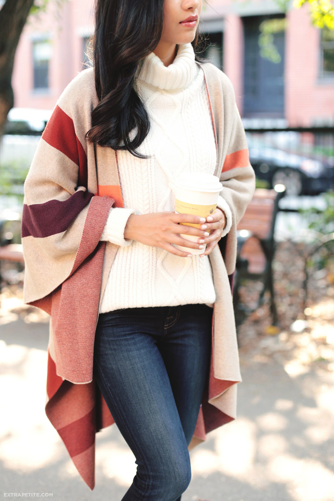 Jean Wang wears her blanket coat over a cream knit jumper and denim jeans; a simple but stylish look perfect for Autumn!  Sweater: Talbots.