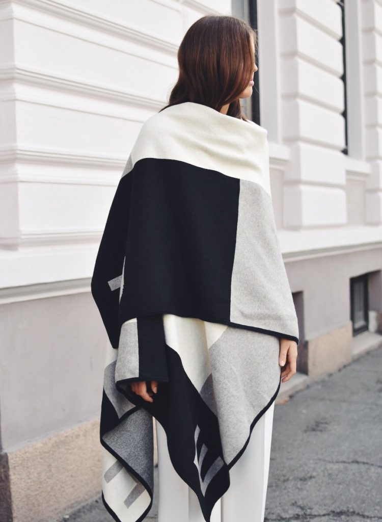 Darja Barannik looks super cool in this monochrome poncho from Hope.   Tee: Elle&il, Shoes: Prada, Trousers: Mango.