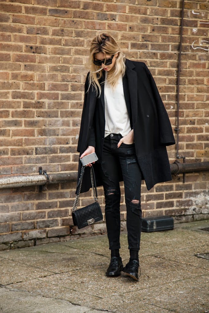 Chain Trend: Camille Charriere with her Boy bag from Chanel. It is the chaing and the quilted pattern that does it for us.