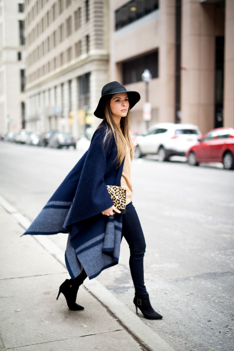 Pam Hetlinger is wearing a navy blue Club Monaco blanket coat