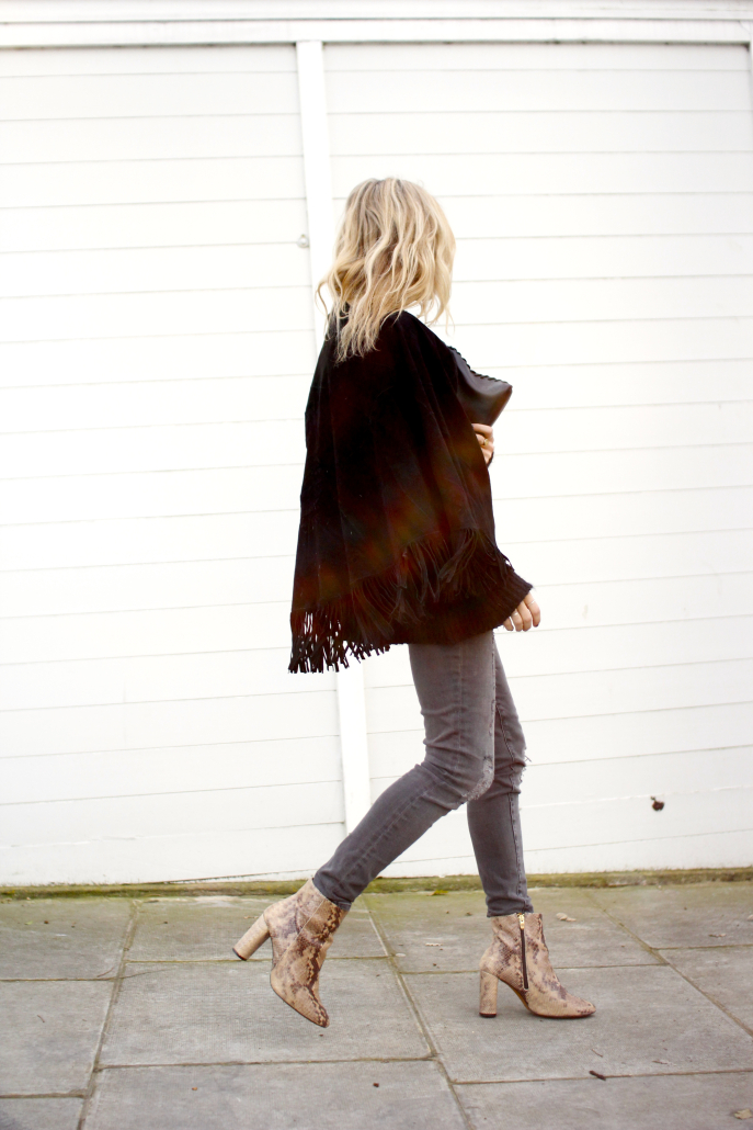 Blanket Coat Outfit and Ideas: Lucy Williams is wearing a Maje black poncho