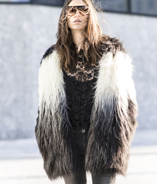 Erika Boldrin is wearing a faux fur coat from Oui Odile