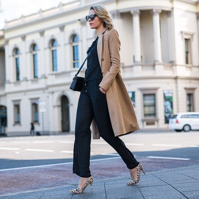 Dasha Gold is wearing an all black and camel outfit