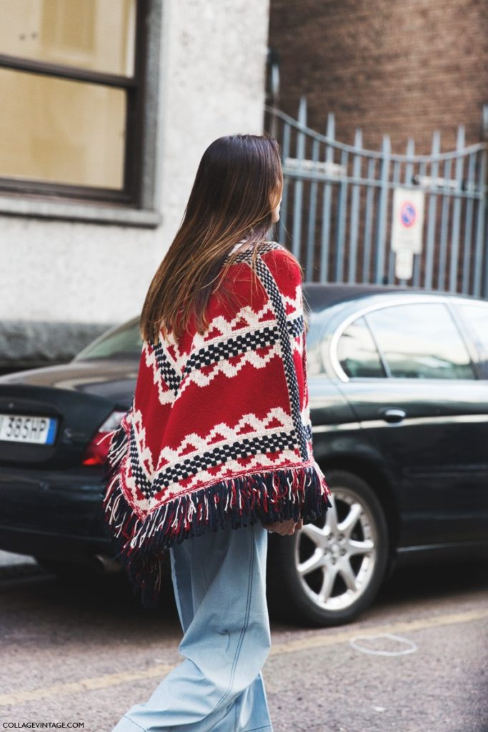 Sara Escudero is wearing an aztec print blanket coat