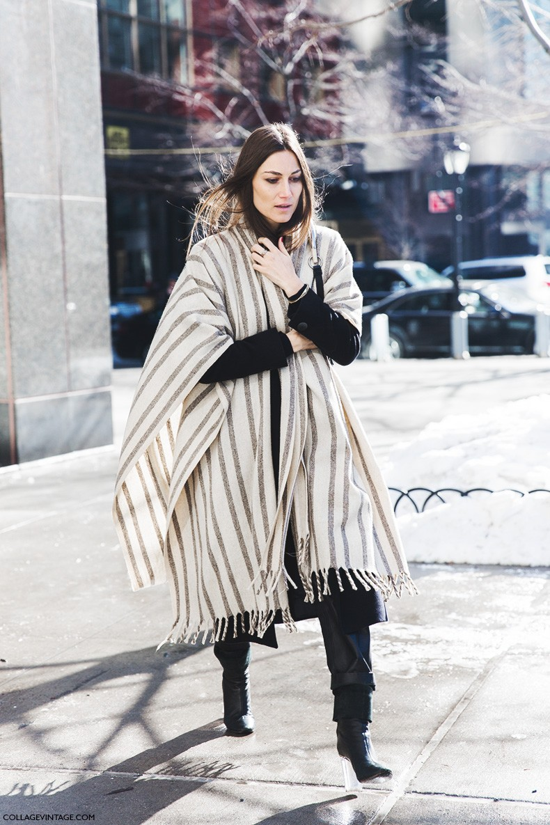 Sara Escudero is wearing a a striped blanket coat