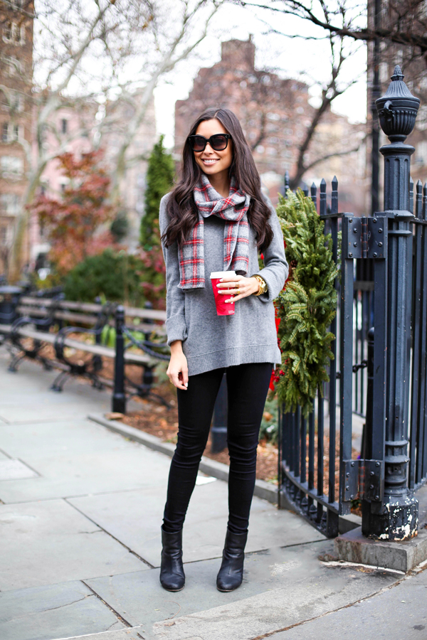 Kat Tanita is wearing a plaid scarf from Faribault, grey sweater from Cynthia Rowley, black jeans from Levi's and the boots are from Rag & Bone