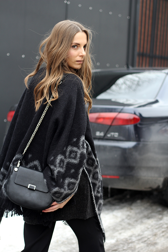 Vanja Milicevic is wearing a black and grey poncho from Zara