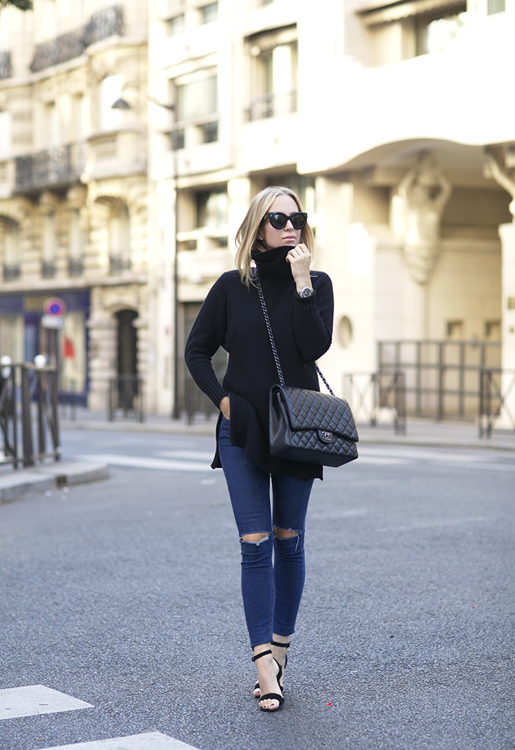 Helena Glazer looks effortlessly chic in a simple black turtleneck jumper and skinny jeans. Sweater: Banana Republic, Denim: Topshop, Shoes: Steven Madden.