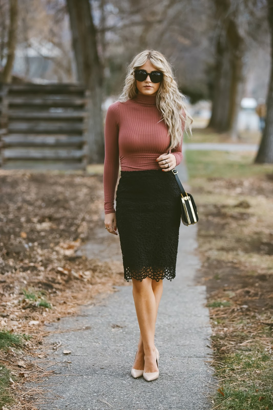 Cara Loren wears this tight fitting ribbed turtle neck top with a black lace midi skirt; a simple and stylish way to wear the trend. Wear this look with tights and a cropped jacket on colder days for an easy every day style. Top: Windsor, Skirt: Bloomingdales.