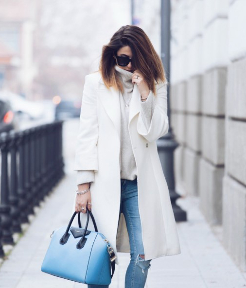 Street Style: Nicoletta Reggio is wearing a white coat from Castellani, sweater and jeans fromZara, and the blue bag is from Givenchy