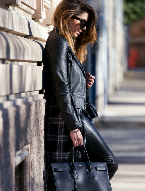 Street Style January 2015: Nicoletta Reggio is wearing a leather jacket from Gas, leather trousers from Zara, plaid flannel shirt from Zara and the bag is from Saint Laurent