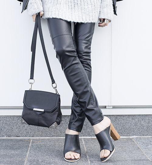 Melissa Araujo is wearing a turtleneck from Zara, conscious leather trousers from H&M, Bee mules from Tibi and the  bag is from Alexander Wang