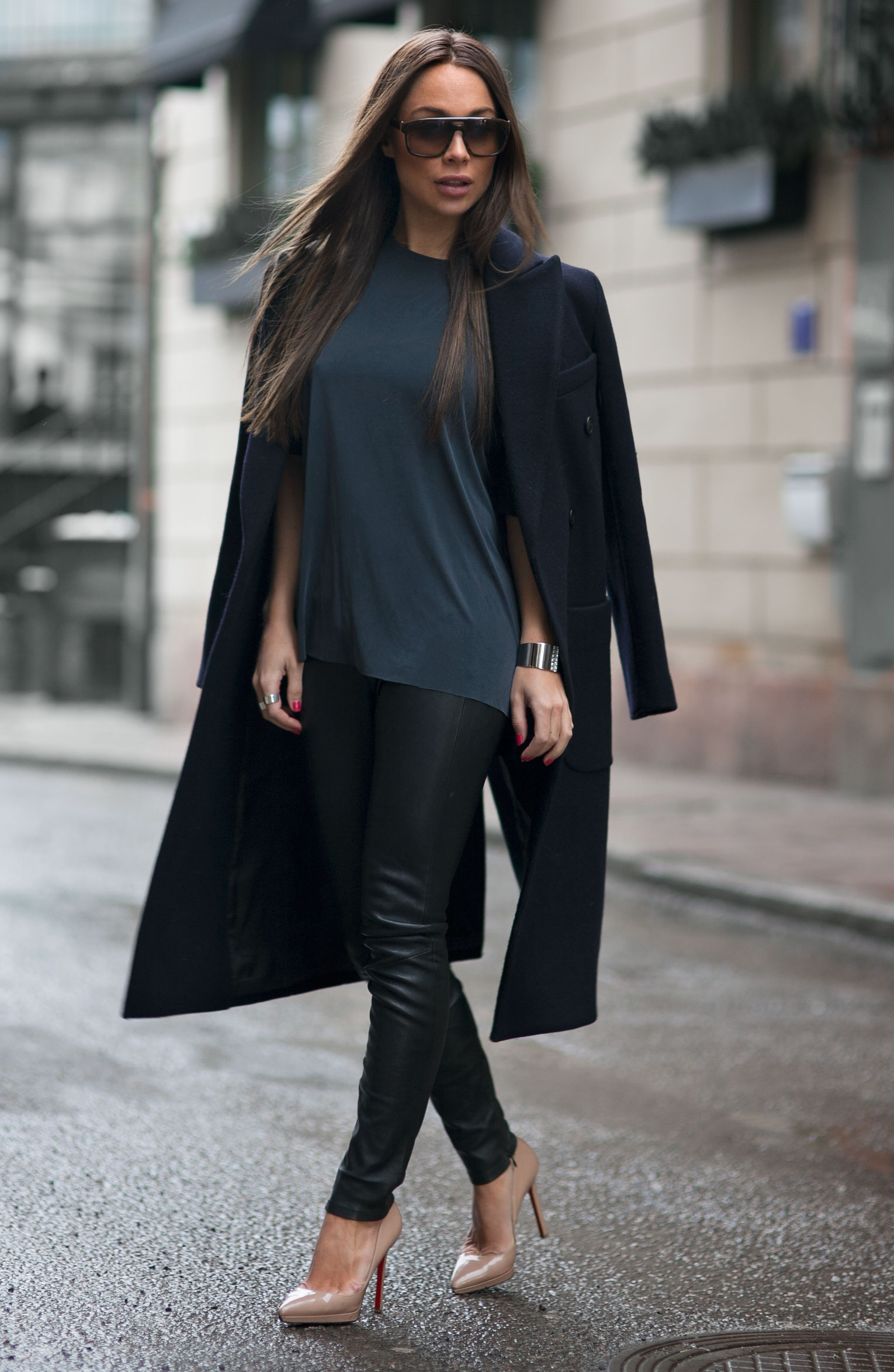 Johanna Olsson is wearing a black long coat from LXLS, T-shirt from Lindex, leather trousers from David Lerner, and the shoes are from Christian Loboutin