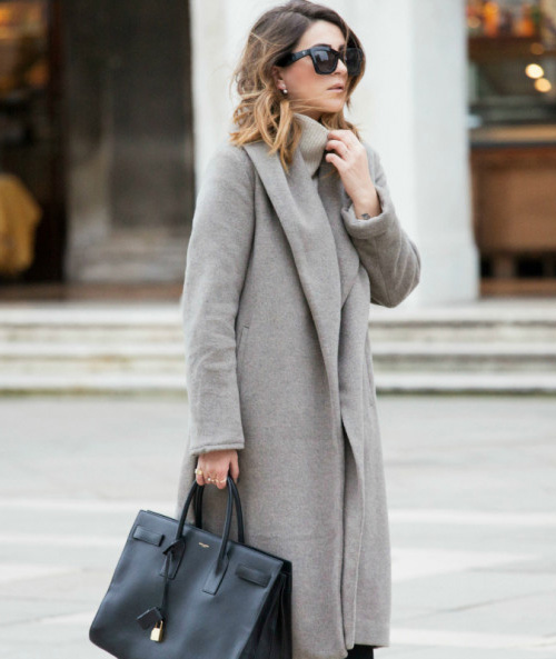 Nicoletta Reggio is wearing a grey coat and sweater from Zara and the black bag is from Saint Laurent