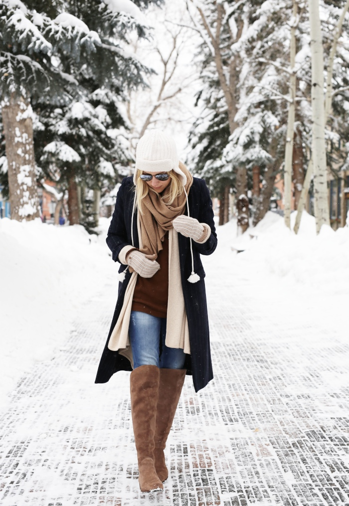 Jacey Duprie is wearing a brown sweater from Reformation, beanie from White Trapper, jeans from Anine Bing, boots from Dolce Vitacardigan from Vince Drape and the coat is from Zara
