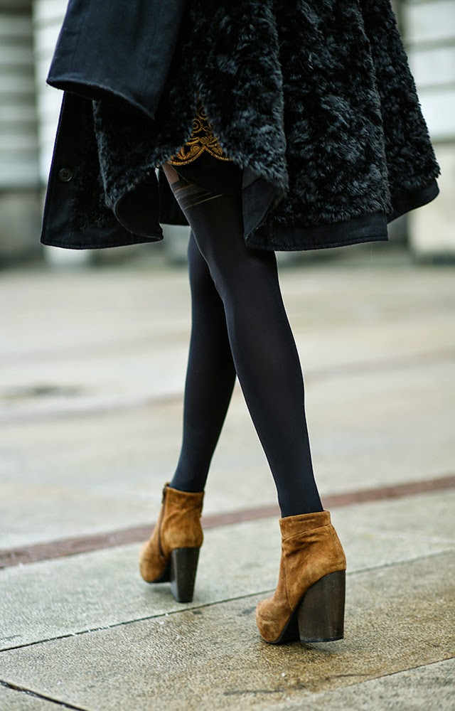 Julietta Kuczyńska is wearing brown suede ankle boots from Vagabond
