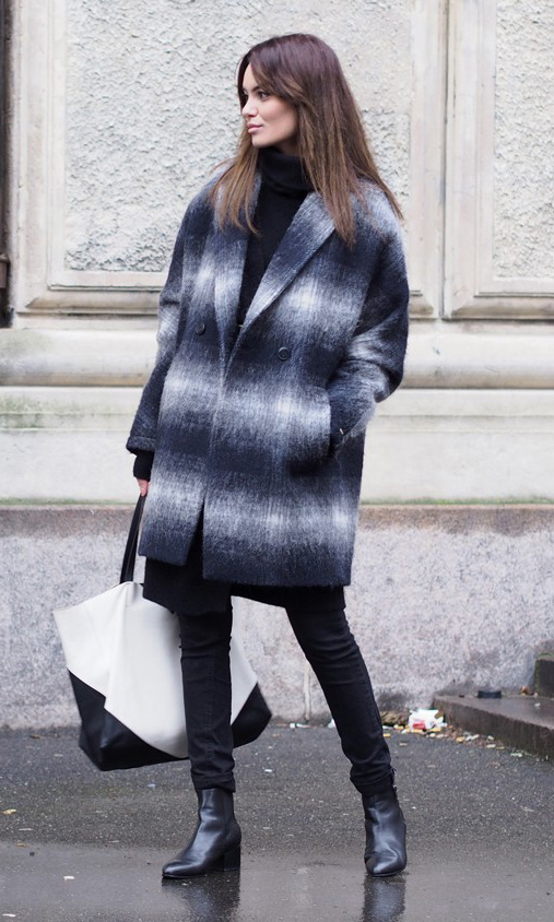 Funda Christophersen is wearing a check wool cocoon coat from Tommy Hilfiger, black turtleneck from Perfectly Simple, black and white bag from Celine and the boots are from Opening Ceremony