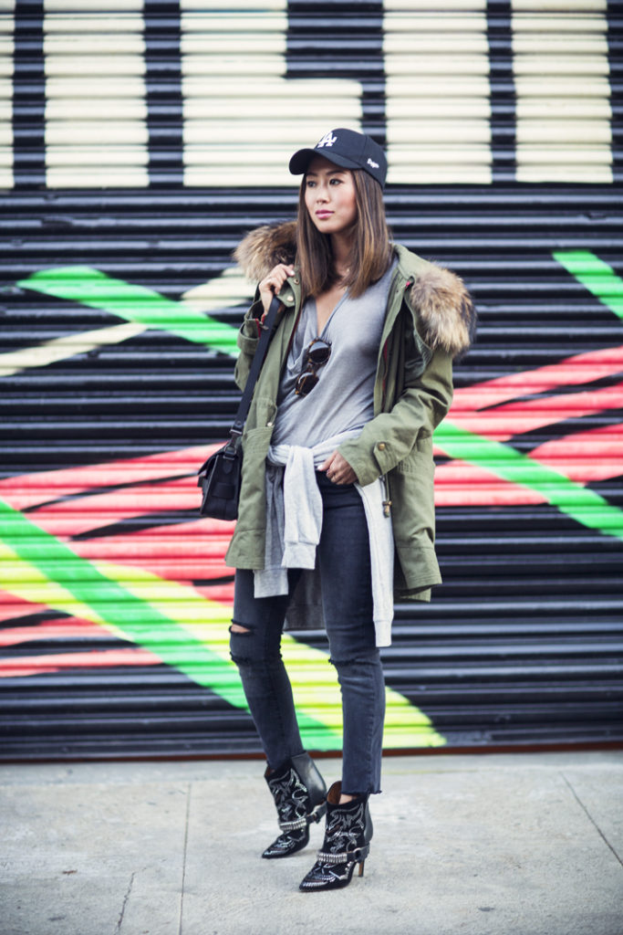 Aimee Song is wearing a parka jacket from Minusey, grey T-Shirt from Kain, black jeans from J Brand and the boots are from Isabel Marant