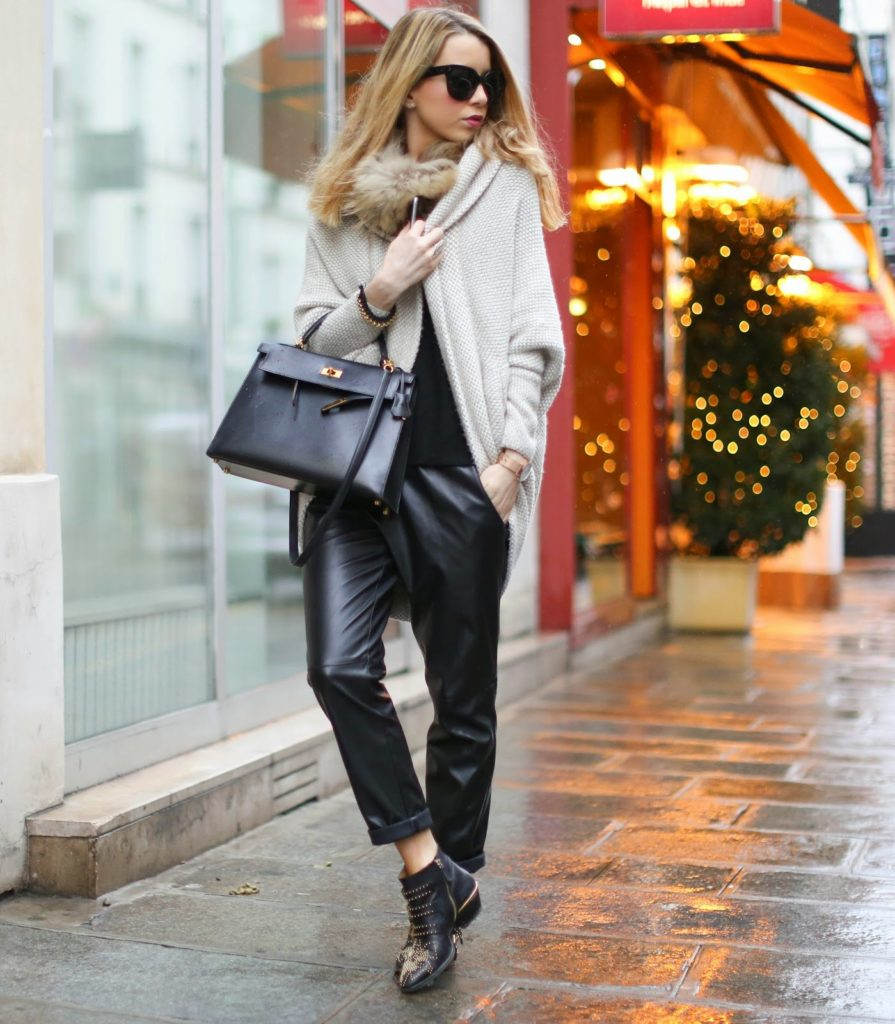 Caroline Louis is wearing a cardigan from Zara, trousers from l'Art du Basic, embellished boots from Chloé and the bag is from Hermès