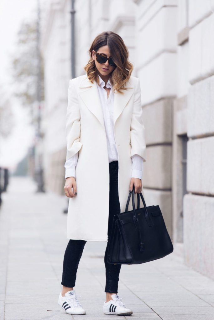 Street Style January 2015: Nicoletta Reggio is wearing a white coat from Flavio Castellani, black trousers from Jennifer, shoes from Adidas and the bag is from Saint Laurent