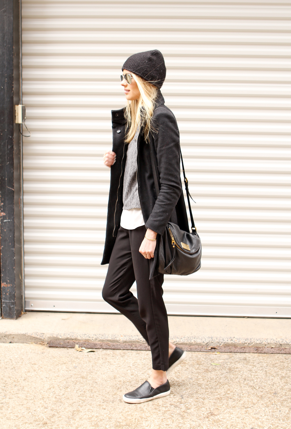 3a0efcf1 Amy Jackson is wearing a black jacket and beanie from Zara, grey top from  Goodnight