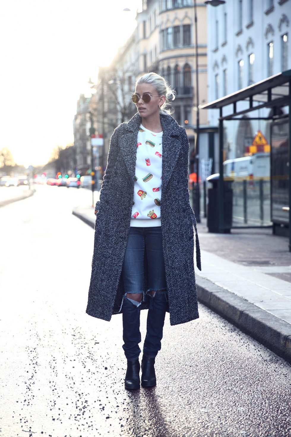 Elsa Ekman is wearing a grey robe coat from River Island, printed top from Criminal Damage, jeans from H&M and the boots are from Jeffery Campbell