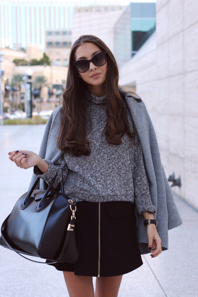 Felicia Akerstrom is wearing a grey coat from Zara, sweater and skirt from TopShop and the bag is from Givenchy