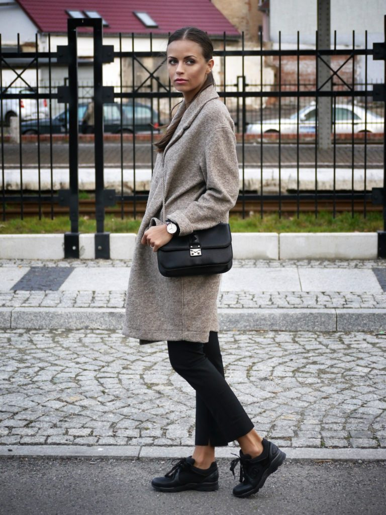 Street Style January 2015: Dorota Gol is wearing black sneakers from Chanel, black trousers from Zara, tan coat from Unisono and the bag is from Valentino