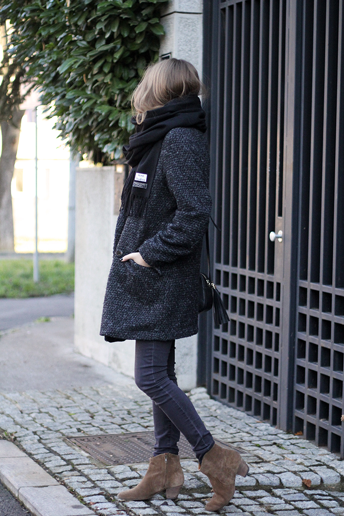 Street Style, January: Vanja Milicevic is wearing boots from Isabel Marant, black skinny jeans and charcoal coat from Mango and the scarf is from Acne Studios