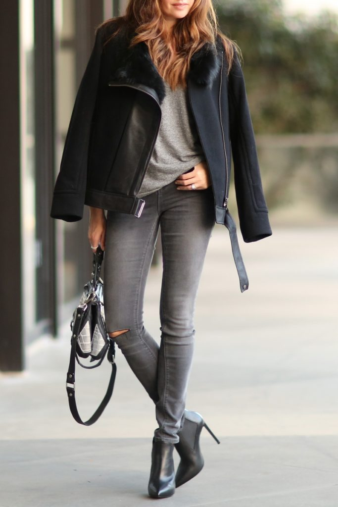 Erica Hoida is wearing a black jacket from Helmut Lang, grey jeans from Asos, grey top from Current Elliott, shoes from Saint Laurent and the bag is from Golden Lane