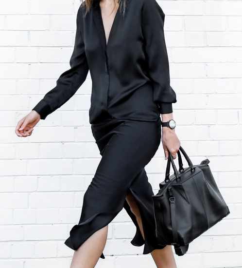 Kaitlyn Ham is wearing a black shirt dress from Christopher Esber and the bag is from Alexander Wang