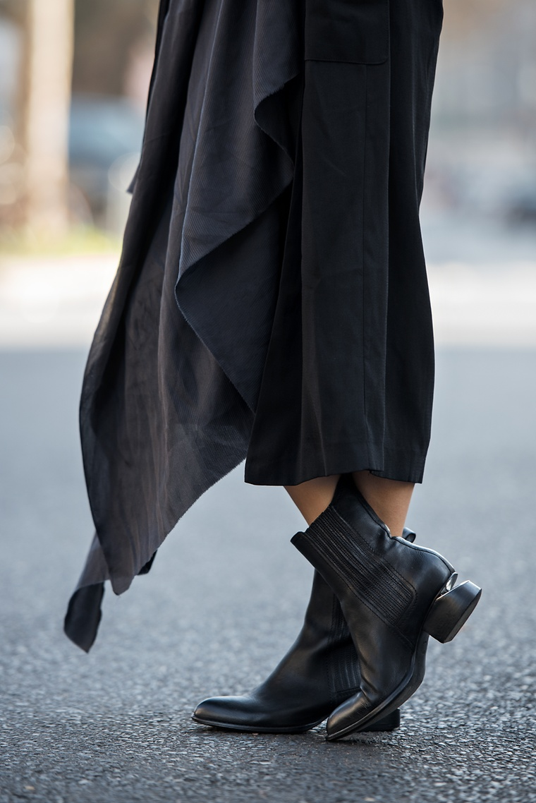 Alice M. Huynh is wearing the black Anouk ankle boot with Rhodium from Alexander Wang