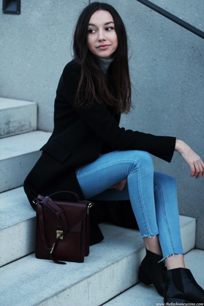 Beatrice Gutu is wearing a black coat and matching boots from Zara, jeans from Missguided and a vintage bag