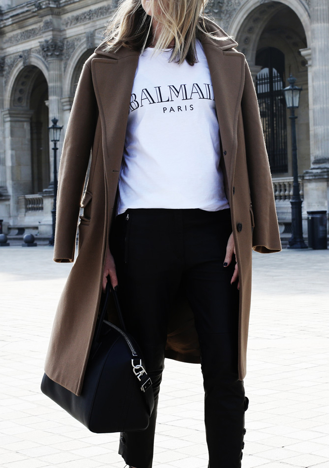 Mandy Shadforth is wearing a brown coat and T-Shirt from Balmain, leather trousers from Isabel Marant and the bag is from Givenchy