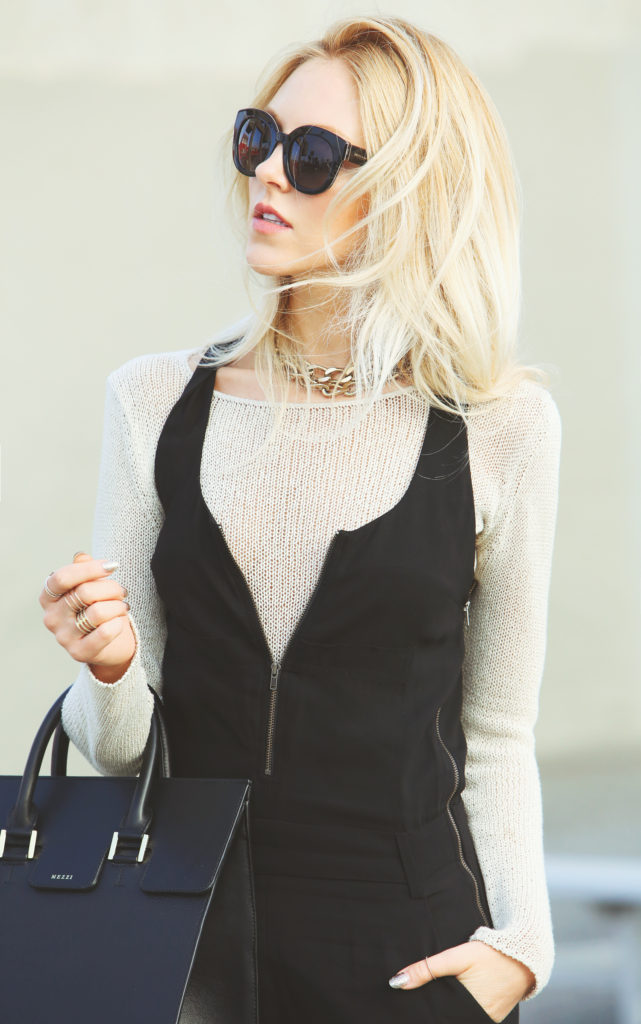 Shea Marie is wearing a white knit jumper from A.L.C and the bag is from Mezzi